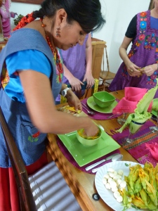 Nora shows us how to lay out squash blossoms and cheese balls in our soup bowls