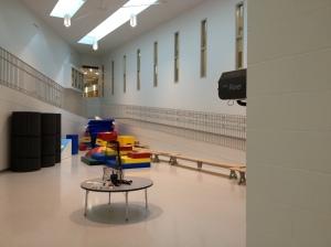 A ramp surrounds the bright central atrium